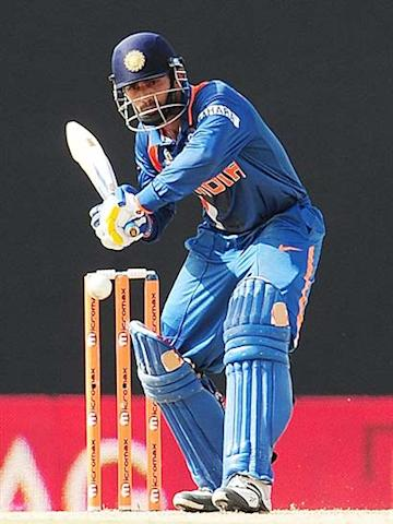 Dinesh Karthik hits a ball during the sixth One-Day International between India and Sri Lanka of the Asia Cup. (AFP Photo)