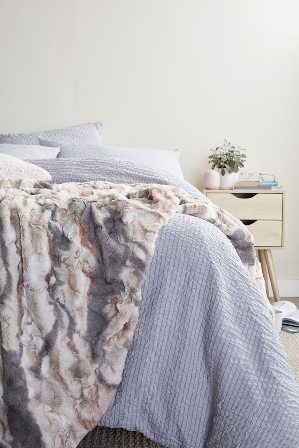 Coles will also be selling a $19.99 faux fur throw and a machine washable wool blend queen size doona for $54.99. Photo: Supplied