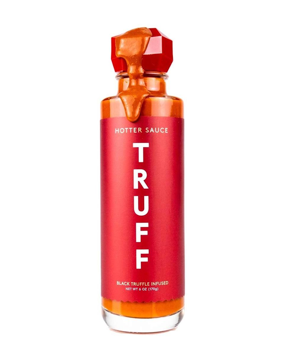 """<h3>Truff Hotter Sauce</h3><br>The purveyors of truffle-infused hot sauce are here to challenge your taste buds with an extra-hot version of its bestselling bottle, made in collaboration with Product(RED) to support the global fight against AIDS. <br><br><strong>TRUFF</strong> Hotter Sauce, $, available at <a href=""""https://amzn.to/3nHDURR"""" rel=""""nofollow noopener"""" target=""""_blank"""" data-ylk=""""slk:Amazon"""" class=""""link rapid-noclick-resp"""">Amazon</a>"""