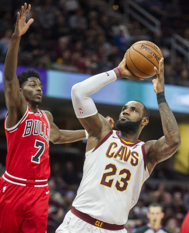 Cleveland Cavaliers' LeBron James (23) shoots past Chicago Bulls' Justin Holiday (7) during the first half of an NBA preseason basketball game in Cleveland, Tuesday, Oct. 10, 2017. (AP Photo/Phil Long)