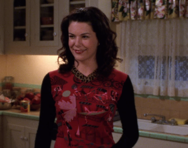 Ah, now we really get down to it. Lorelai hosts Rory's birthday party in a long-sleeve shirt so achingly aughts, with its contrasting prints, long sleeves, V-neck and vivid colors, that it's almost hard to believe.