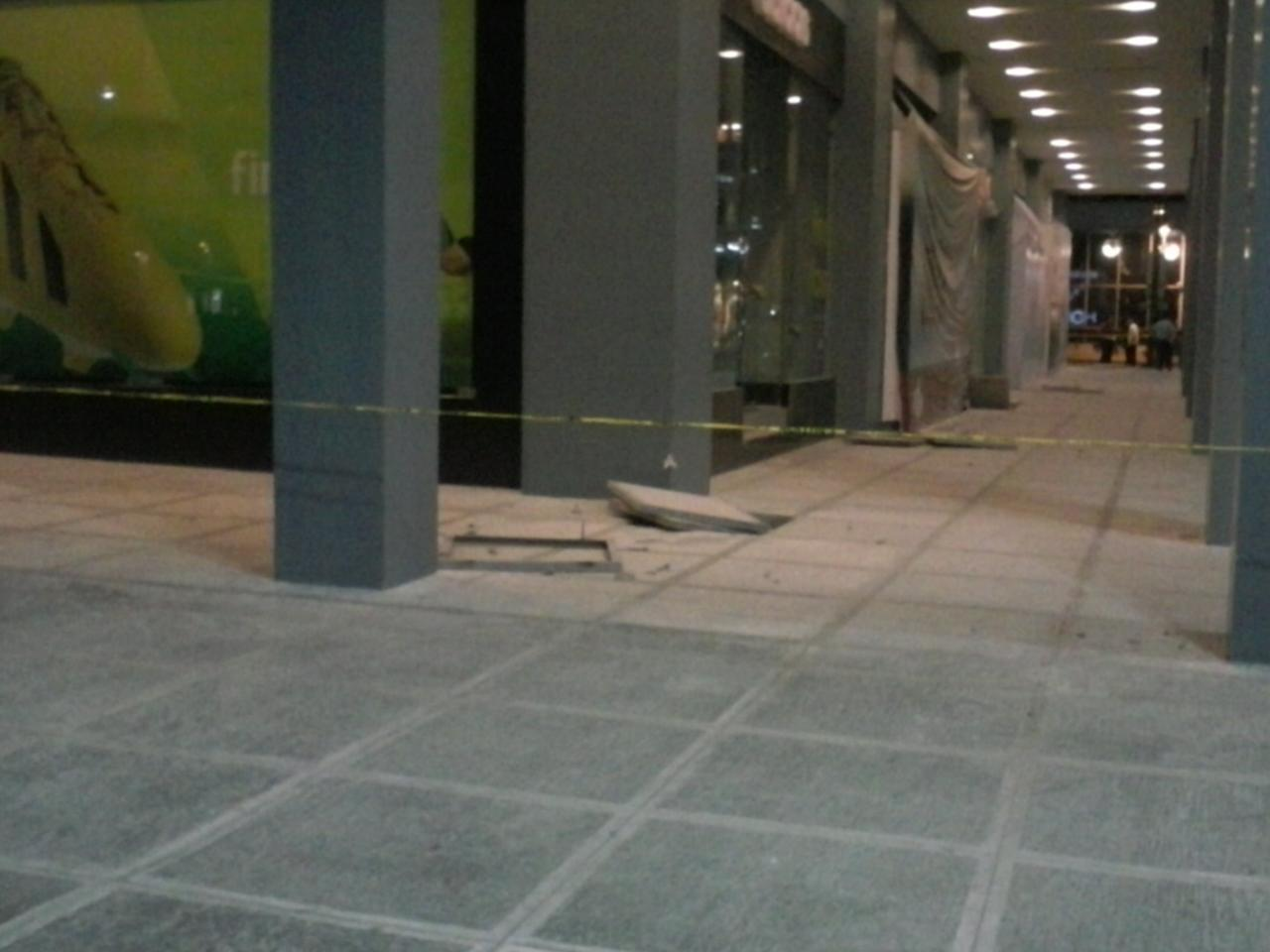 A minor explosion damaged this pathway in Bonifacio Global City in Taguig. Photo by Sid Ventura