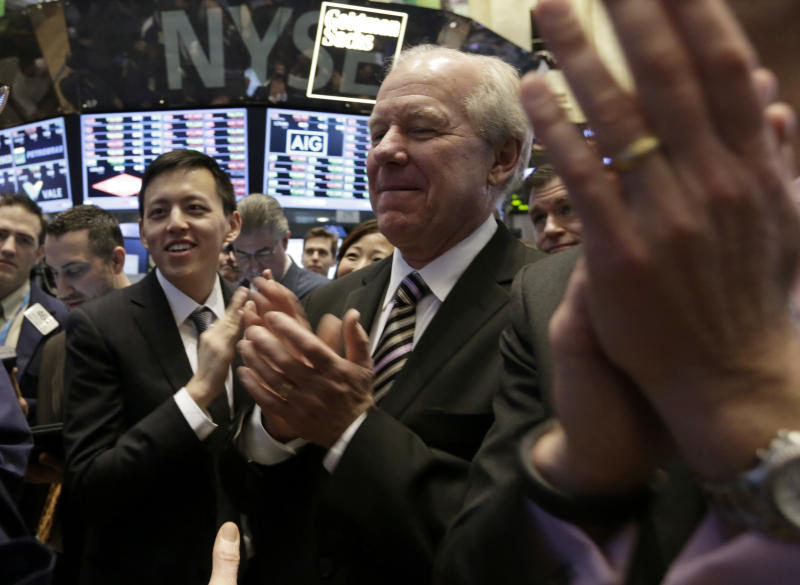 Intrawest Resorts Holdings CEO William Jensen, center, applauds as on the floor of the New York Stock Exchange as his company's begins trading, Friday, Jan. 31, 2014. Denver-based Intrawest is a mountain resort and adventure company. (AP Photo/Richard Drew)