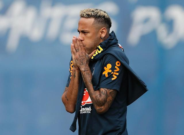 Neymar had hobbled out of Brazil training on Tuesday (AFP Photo/Adrian DENNIS)