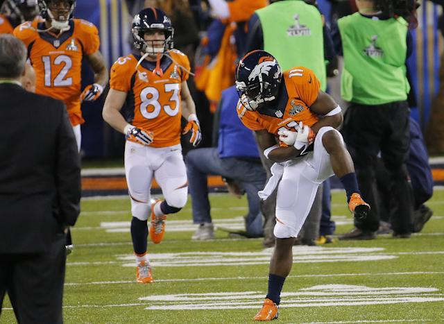 Denver Broncos' Trindon Holliday (11) gestures in front of Wes Welker (83) as he comes out of the field to warm up before the NFL Super Bowl XLVIII football game against the Seattle Seahawks Sunday, Feb. 2, 2014, in East Rutherford, N.J. (AP Photo/Matt York)