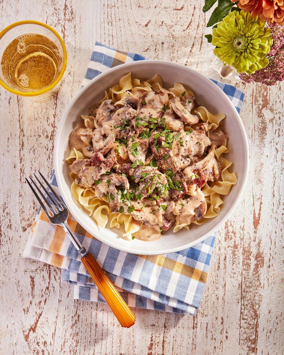 """<p>Other versions of this classic Eastern European comfort food can take hours to put together. This one can beats your your go-to delivery app to the table, and it's yummy enough that the kids'll lick their plates clean. </p><p><strong><a href=""""https://www.countryliving.com/food-drinks/a36868206/beef-stroganoff/"""" rel=""""nofollow noopener"""" target=""""_blank"""" data-ylk=""""slk:Get the recipe"""" class=""""link rapid-noclick-resp"""">Get the recipe</a>.</strong></p>"""