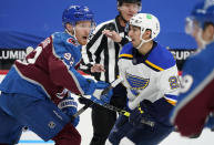 Colorado Avalanche left wing Gabriel Landeskog, left, pursues the puck with St. Louis Blues center Jordan Kyrou after a faceoff in the second period of an NHL hockey game Friday, Jan. 15, 2021, in Denver. (AP Photo/David Zalubowski)