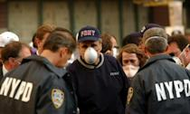 """Giuliani -- shown here wearing a dust mask after a tour of the damage in Lower Manhattan on September 12, 2001 -- earned the accolade """"America's Mayor"""" for his calm leadership of New York in the wake of the 9/11 attacks"""