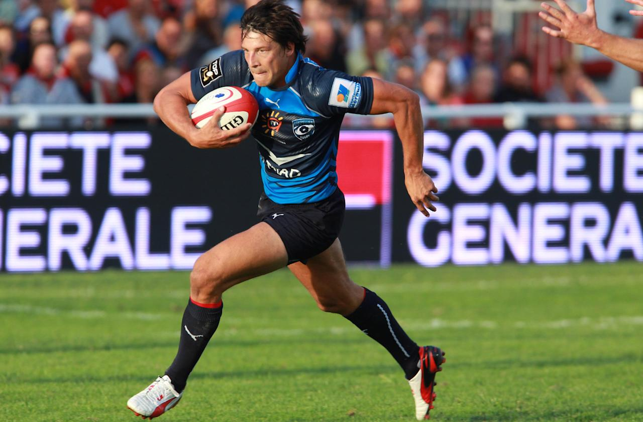 Montpellier's Francois Trinh Duc evades to scores a try against Biarritz during his French Top 14 rugby union match at the Stade Aguilera, in Biarritz, southwestern France, Saturday Aug. 24, 2013. (AP Photo/Bob Edme)