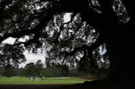 Graeme McDowell, of Northern Ireland, and Shane Lowry, of Ireland, walk down the 18th fairway during a practice round for the Masters golf tournament Wednesday, Nov. 11, 2020, in Augusta, Ga. (AP Photo/Charlie Riedel)