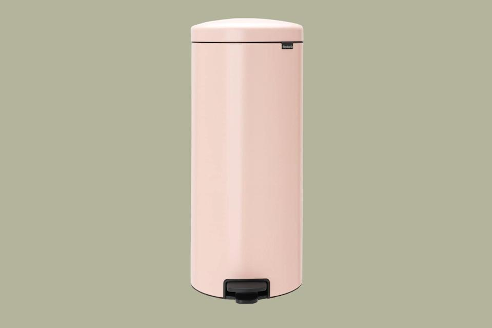 """<p>If you're searching for a functional kitchen garbage bin with vintage appeal, we found the style for you. Available in a rainbow of colors, this rounded, foot pedal-operated iteration is designed with a removable inner bucket for <a href=""""https://www.marthastewart.com/1513164/kitchen-cleaning-tips"""" rel=""""nofollow noopener"""" target=""""_blank"""" data-ylk=""""slk:foolproof cleanup"""" class=""""link rapid-noclick-resp"""">foolproof cleanup</a>.</p> <p><strong><em>Shop Now: </em></strong><em>Brabantia Step Trash in Clay Pink, $69.99, </em><a href=""""https://www.amazon.com/Brabantia-Trash-newIcon-Plastic-Bucket/dp/B01LY0EGWW/ref=as_li_ss_tl?ie=UTF8&linkCode=ll1&tag=mslhomesleektrashcanscbiggssep20-20&linkId=a41a01de9eb194525a94f629887dcfaa"""" rel=""""nofollow noopener"""" target=""""_blank"""" data-ylk=""""slk:amazon.com"""" class=""""link rapid-noclick-resp""""><em>amazon.com</em></a><em>.</em></p>"""