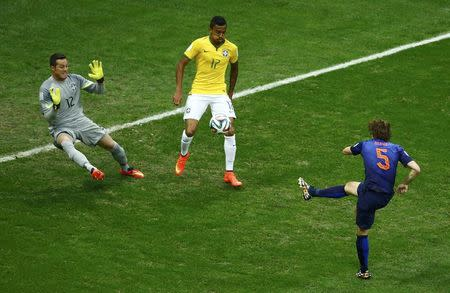 Daley Blind of the Netherlands scores past Brazil's goalkeeper Julio Cesar during their 2014 World Cup third-place playoff at the Brasilia national stadium in Brasilia July 12, 2014. REUTERS/Ruben Sprich