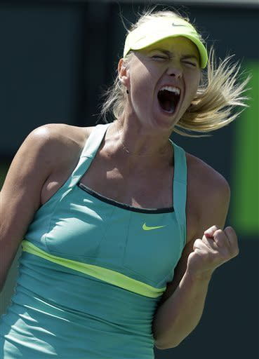 Maria Sharapova, of Russia, reacts after wining the first set against Sara Errani, of Italy, during the quarterfinals of the Sony Open tennis tournament, Wednesday, March 27, 2013, in Key Biscayne, Fla. (AP Photo/Lynne Sladky)
