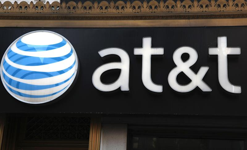 FILE-This May 6, 2012, file photo, shows an AT&T sign at a store in New York. AT&T is seeing declining smartphone sales, leading to the best profitability ever in its wireless arm as it saves on phone subsidies. The largest telecommunications company in the U.S. says it activated 5.1 million smartphones in its latest quarter, down from 5.5 million in the same period a year ago.  (AP Photo/CX Matiash, File)
