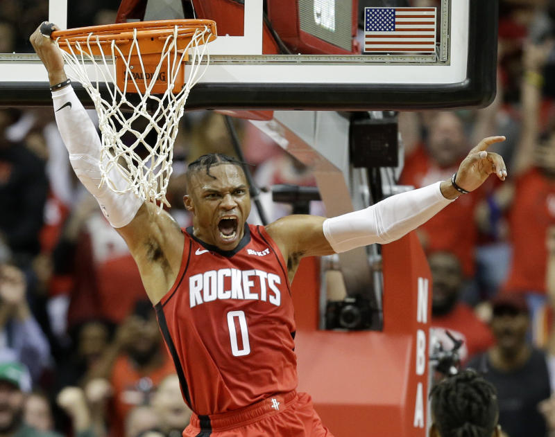 Houston Rockets guard Russell Westbrook celebrates his dunk during the second half of the teams NBA basketball game against the Milwaukee Bucks, Thursday, Oct. 24, 2019, in Houston. (AP Photo/Eric Christian Smith)
