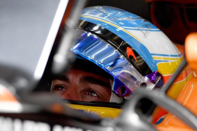 McLaren's Fernando Alonso sits in his car during the third practice session ahead of qualifying for the Bahrain Formula One Grand Prix at the Sakhir circuit in Manama on April 15, 2017 (AFP Photo/ANDREJ ISAKOVIC)