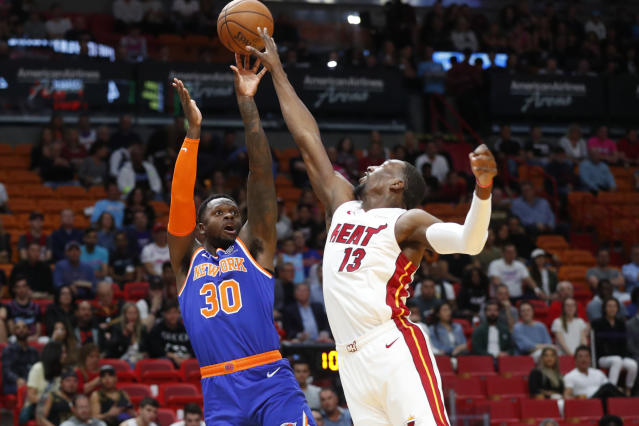 New York Knicks forward Julius Randle (30) shoots over Miami Heat center Bam Adebayo (13) during the first half of an NBA basketball game Friday, Dec. 20, 2019, in Miami. (AP Photo/Wilfredo Lee)