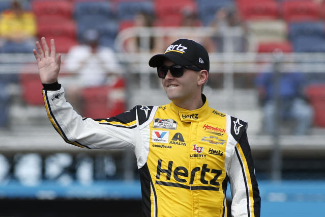 William Byron waves to fans during driver introductions prior to the NASCAR Cup Series auto race at Phoenix Raceway, Sunday, March 8, 2020, in Avondale, Ariz. (AP Photo/Ralph Freso)