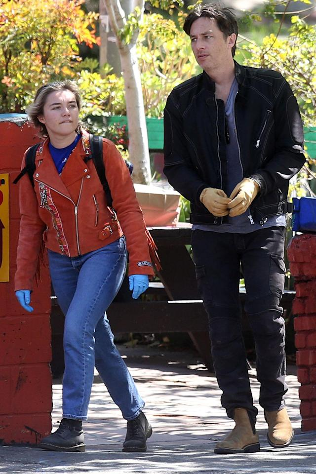 <p>Florence Pugh and Zach Braff keep their hands covered during a walk in Los Angeles on Saturday.</p>