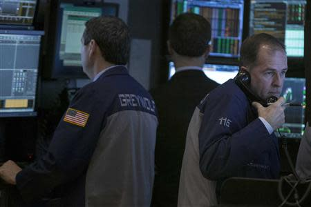 Traders work on the floor of the New York Stock Exchange February 12, 2014. REUTERS/Brendan McDermid