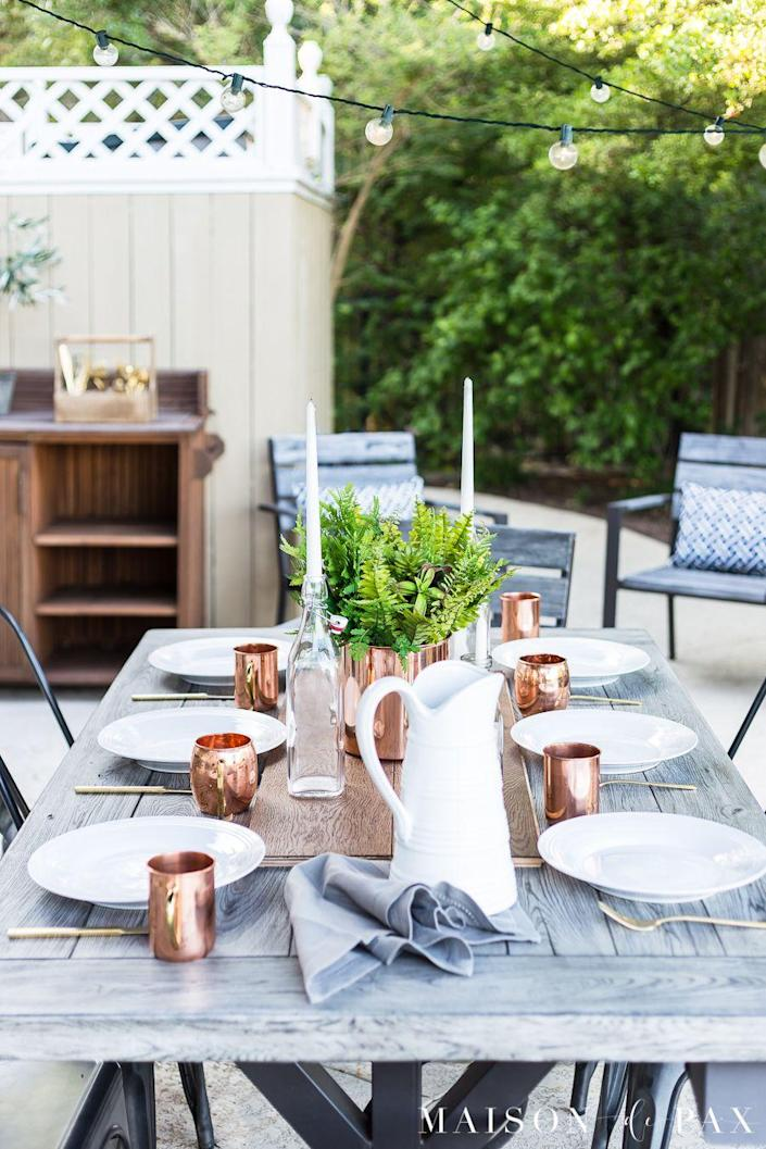 """<p>No need to go overboard with the lighting. Just a simple strand draped over the table will look effortless. Plus, it will let your beautiful tablescape take center stage. </p><p><strong>See more at <a href=""""https://www.maisondepax.com/casually-elegant-summer-outdoor-dining/"""" rel=""""nofollow noopener"""" target=""""_blank"""" data-ylk=""""slk:Maison de Pax"""" class=""""link rapid-noclick-resp"""">Maison de Pax</a>.</strong></p><p><a class=""""link rapid-noclick-resp"""" href=""""https://www.amazon.com/Backyard-Hanging-Outdoor-Pergola-Deckyard/dp/B00RQHBZVS/?tag=syn-yahoo-20&ascsubtag=%5Bartid%7C10050.g.3404%5Bsrc%7Cyahoo-us"""" rel=""""nofollow noopener"""" target=""""_blank"""" data-ylk=""""slk:SHOP STRING LIGHTS"""">SHOP STRING LIGHTS</a></p>"""