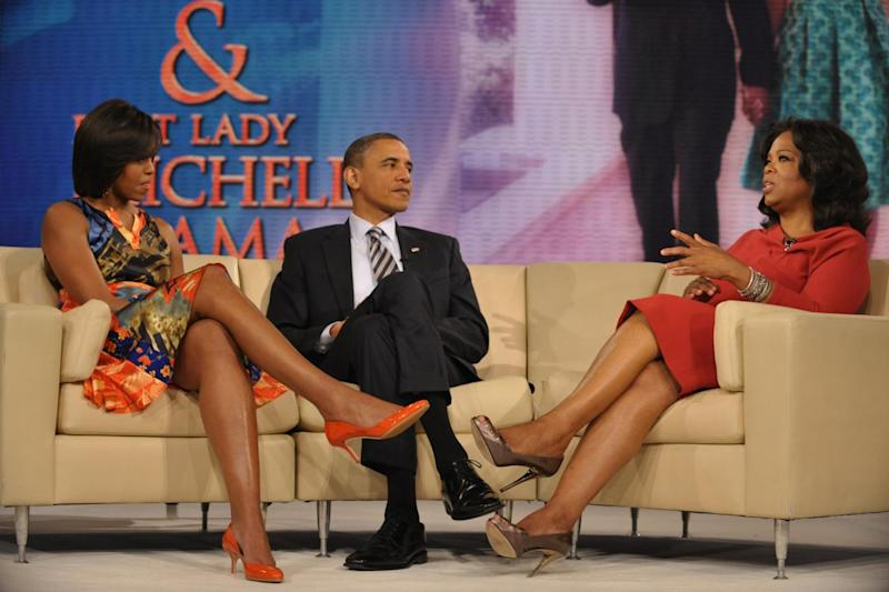 In the hot seat: Oprah Winfrey with Barack and Michelle Obama (Mandel Ngan/AFP/Getty)
