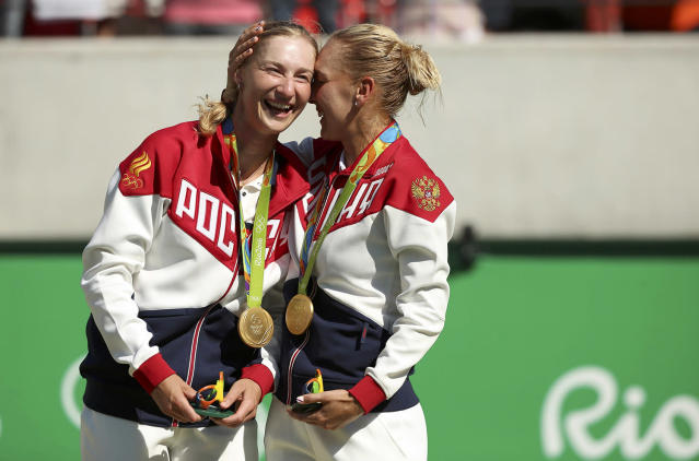 <p>Elena Vesnina and Ekaterina Makarova of Russia react after receiving their gold medals for the women's doubles tennis final at the Olympic Tennis Center in Rio on August 14, 2016. (REUTERS/Kevin Lamarque) </p>