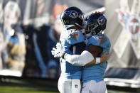 Tennessee Titans tight end Jonnu Smith, right, is congratulated by quarterback Ryan Tannehill, left, after they teamed up on a 2-yard touchdown pass play against the Chicago Bears in the second half of an NFL football game Sunday, Nov. 8, 2020, in Nashville, Tenn. (AP Photo/Wade Payne)