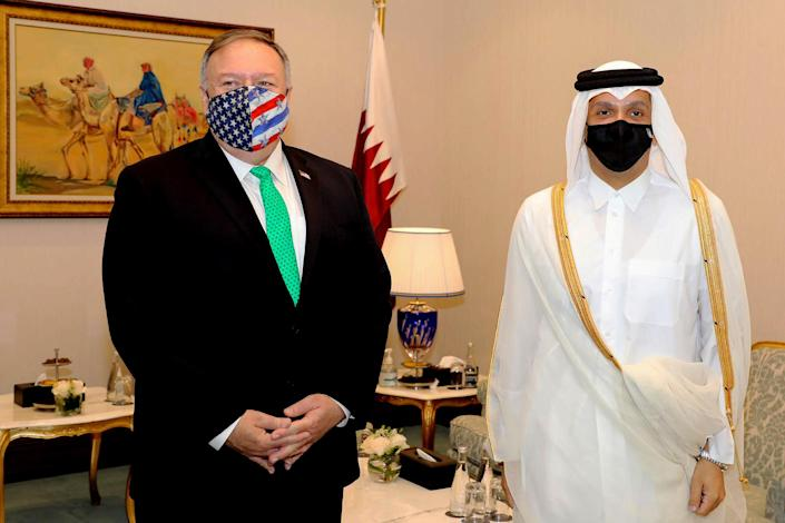 Image: Qatar's Deputy Prime Minister and Foreign Minister Sheikh Mohammed bin Abdulrahman al-Thani meeting with U.S. Secretary of State Mike Pompeo on the sidelines of the opening ceremony of the Afghan negotiations (AFP - Getty Images)