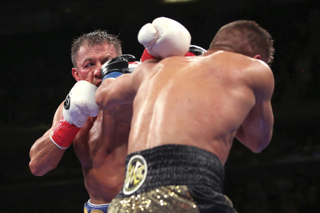 Gennadiy Golovkin, left, is hit on the face by Sergiy Derevyanchenko during the 12th round of an IBF middleweight championship title bout at Madison Square Garden in New York on Saturday, Oct. 5, 2019. Golovkin won by a decision. (AP Photo/Rich Schultz)