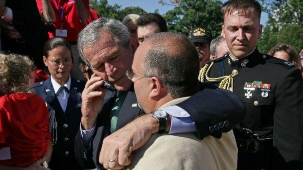 PHOTO: President George W. Bush stands with his arm around Jeff Hallal while speaking on the phone to his wife, Pam Hallal, Sept. 18, 2007 on the South Lawn of the White House. (Eric Draper/Courtesy George W. Bush Presidential Library & Museum)