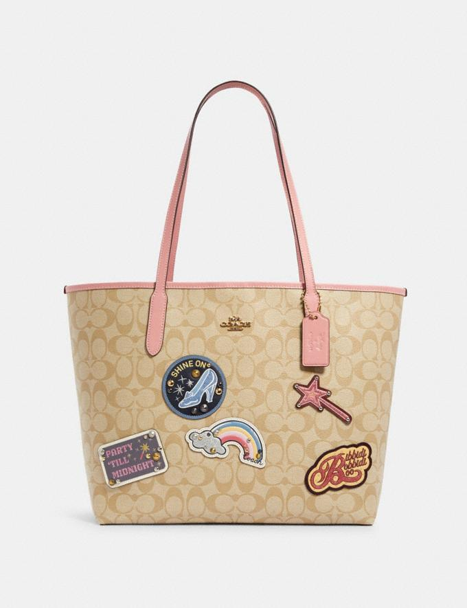 Disney X Coach City Tote In Signature Canvas With Patches. Image via Coach Outlet.
