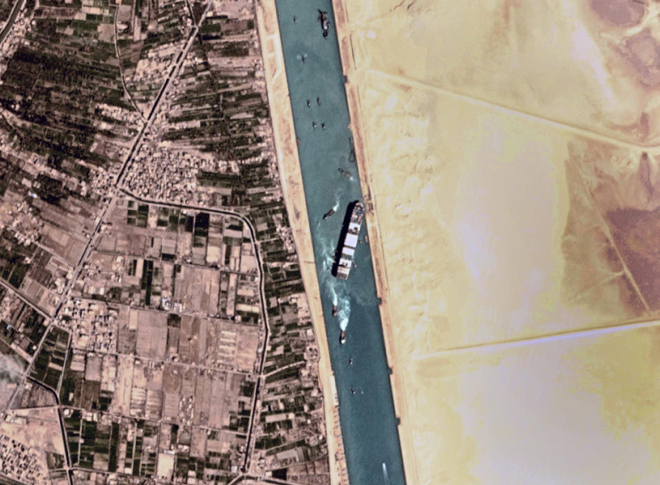 """This satellite photo from Planet Labs Inc. shows the Ever Given cargo ship stuck in Egypt's Suez Canal Monday, March 29, 2021. Engineers on Monday """"partially refloated"""" the colossal container ship that continues to block traffic through the Suez Canal, authorities said, without providing further details about when the vessel would be set free. (Planet Labs Inc. via AP)"""