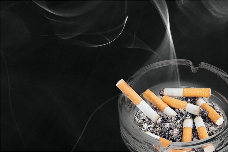 Cigarettes in ashtray.