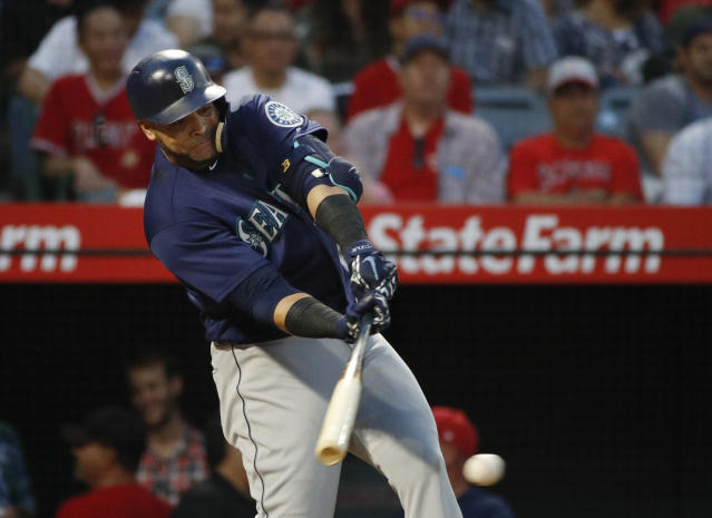 Seattle Mariners' Nelson Cruz hits a two-RBI single during the fourth inning of the team's baseball game against the Los Angeles Angels, Wednesday, July 11, 2018, in Anaheim, Calif. (AP Photo/Jae C. Hong)