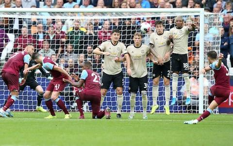 Aaron Cresswell scores with a free-kick - Credit: Getty Images