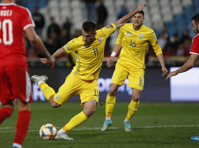 Ukraine's Artem Besedin scores his side's second goal during the Euro 2020 group B qualifying soccer match between Serbia and Ukraine, on the stadium Rajko Mitic in Belgrade, Serbia, Sunday, Nov. 17, 2019. (AP Photo/Darko Vojinovic)