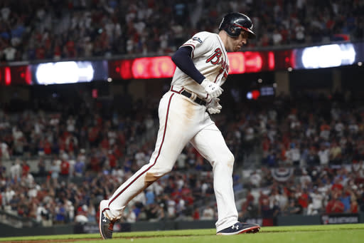 Atlanta Braves first baseman Freddie Freeman (5) rounds ther bases after hitting a solo homer against the St. Louis Cardinals in the ninth inning during Game 1 of a best-of-five National League Division Series, Thursday, Oct. 3, 2019, in Atlanta. (AP Photo/John Bazemore)
