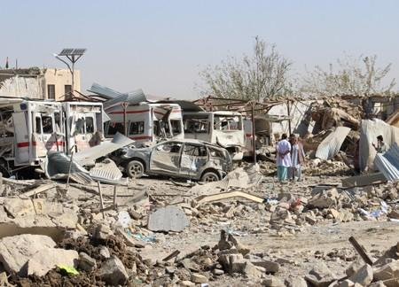 Damaged vehicles are seen at the site of a car bomb attack in Qalat, capital of Zabul province