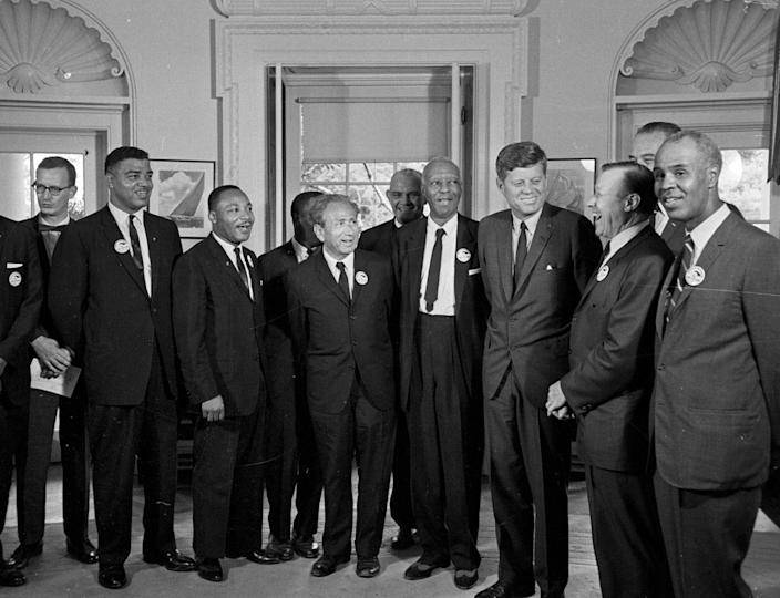 <p>President Kennedy stands with a group of leaders of the March on Washington at the White House in Washington. Immediately after the march, they discussed civil rights legislation that was finally inching through Congress. From second left are Whitney Young, National Urban League; Dr. Martin Luther King, Christian Leadership Conference; John Lewis, Student Non-violent Coordinating Committee, partially obscured; Rabbi Joachim Prinz, American Jewish Congress; Dr. Eugene P. Donnaly, National Council of Churches; A. Philip Randolph, AFL-CIO vice president; Kennedy; Walter Reuther, United Auto Workers; Vice President Lyndon B. Johnson, partially obscured, and Roy Wilkins, NAACP. (AP Photo) </p>