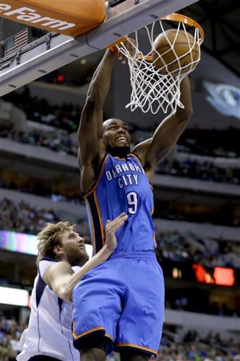 Oklahoma City Thunder power forward Serge Ibaka (9) scores against Dallas Mavericks power forward Dirk Nowitzki (41), of Germany, during the first half of an NBA basketball game, Sunday, March 17, 2013, in Dallas. (AP Photo/LM Otero)