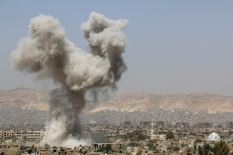 Smoke billows following air strikes by regime forces on April 29, 2015 in the restive Jobar area in eastern Damascus, which has been a battleground for more than two years