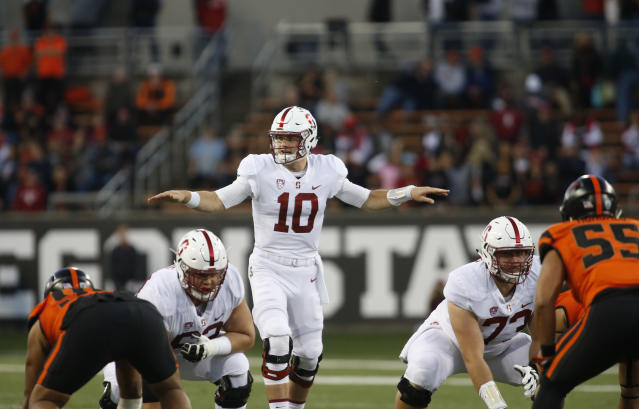 "Stanford quarterback <a class=""link rapid-noclick-resp"" href=""/ncaaf/players/240498/"" data-ylk=""slk:Keller Chryst"">Keller Chryst</a> (10) during the first half of an NCAA college football game, in Corvallis, Ore., Thursday, Oct. 26, 2017. (AP Photo/Timothy J. Gonzalez)"
