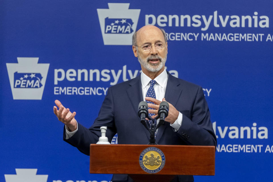 FILE - In this May 29, 2020, file photo, Pennsylvania Gov. Tom Wolf meets with the media at The Pennsylvania Emergency Management Agency (PEMA) headquarters in Harrisburg, Pa. On Wednesday, Aug. 26, 2020, the Justice Department sent letters to the governors of Pennsylvania and three other Democratic-led states, seeking data on whether they violated federal law by ordering public nursing homes to accept recovering COVID-19 patients from hospitals, actions that have been criticized for potentially fueling the spread of the virus. (Joe Hermitt/The Patriot-News via AP, File)