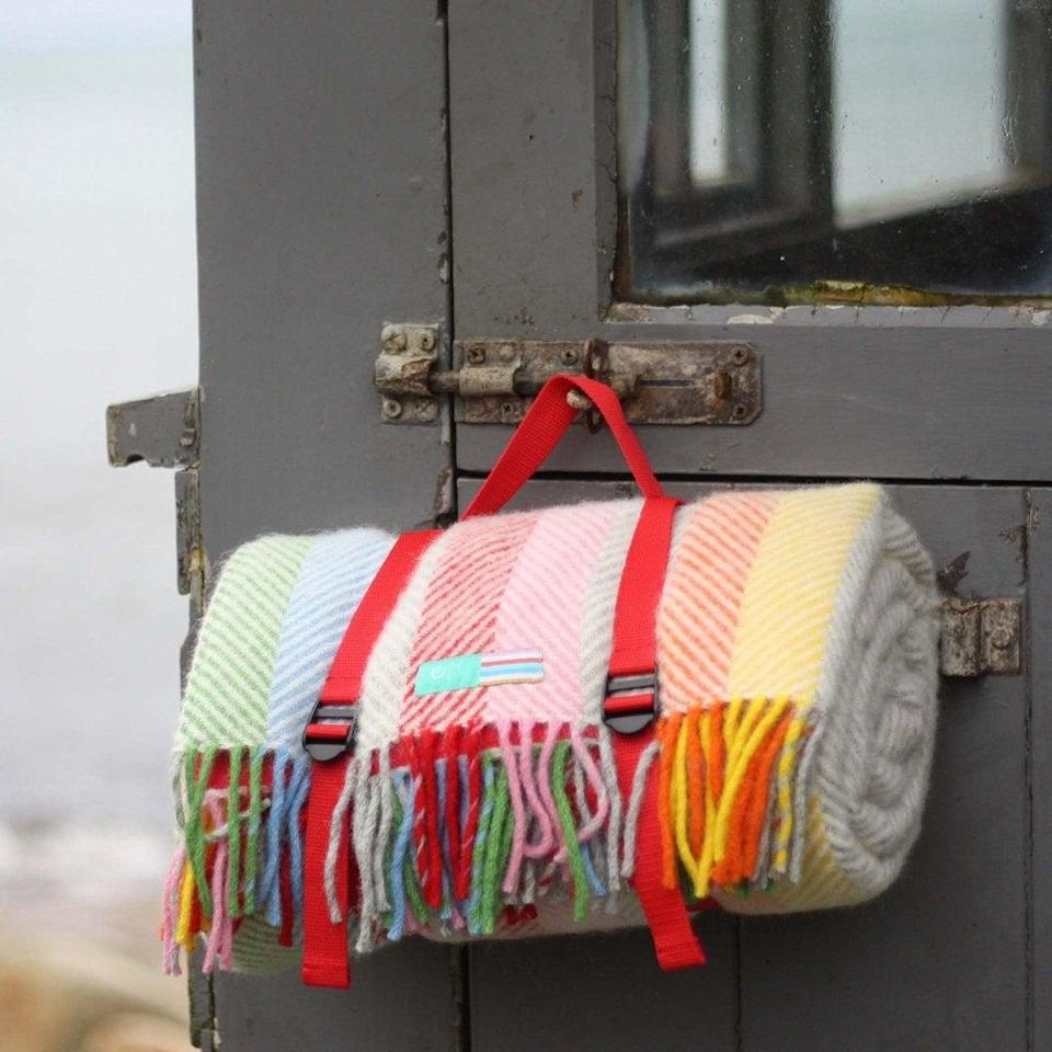 """<strong>Under £150</strong><br><br>I sense a theme… This has been a summer picnic saviour, with its waterproof backing and uplifting rainbow stripe. It's really high quality and also really good value, being 100% wool and made in Britain. <br><br><strong>Ebb Flow Cornwall</strong> Porthminster Picnic Rug, $, available at <a href=""""https://ebbflowcornwall.co.uk/collections/blankets-throws/products/porthminster-picnic-rug"""" rel=""""nofollow noopener"""" target=""""_blank"""" data-ylk=""""slk:Ebb Flow Cornwall"""" class=""""link rapid-noclick-resp"""">Ebb Flow Cornwall</a>"""