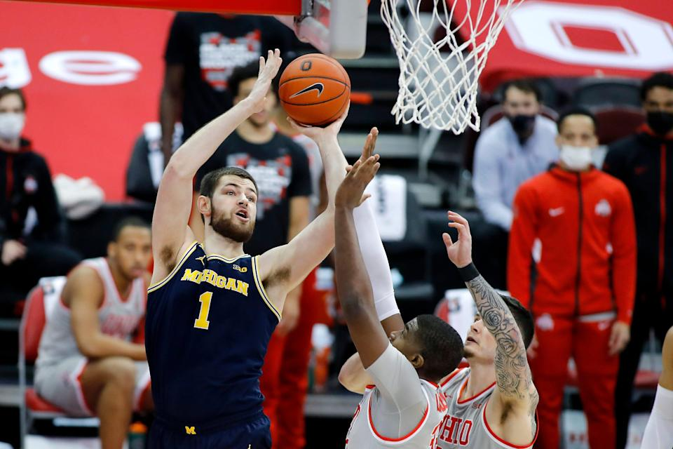 Michigan Wolverines center Hunter Dickinson shoots against Ohio State Buckeyes forward E.J. Liddell during the first half at Value City Arena, Feb. 21, 2021 in Columbus, Ohio.