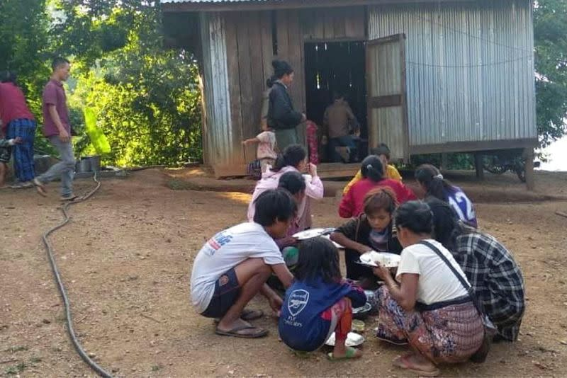 People displaced by fighting share a meal in Myanmar's northwestern Chin State