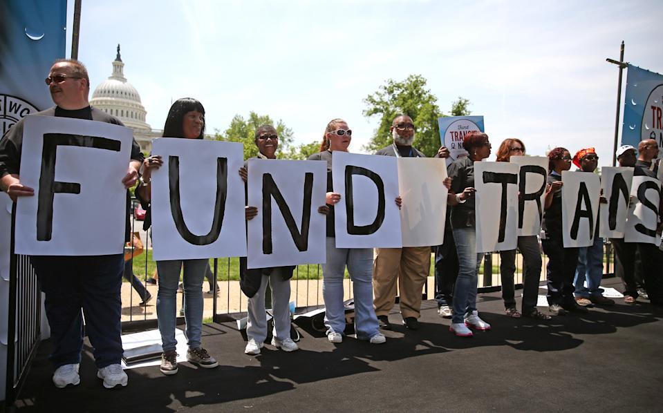 WASHINGTON, DC - MAY 20:  Transit workers participate in a rally to urge Congress to replenish the Highway Trust Fund, on Capitol Hill, May 20, 2014 in Washington, DC. Workers say that the pending highway bill is about more about mass transit and jobs and not just highways.  (Photo by Mark Wilson/Getty Images)