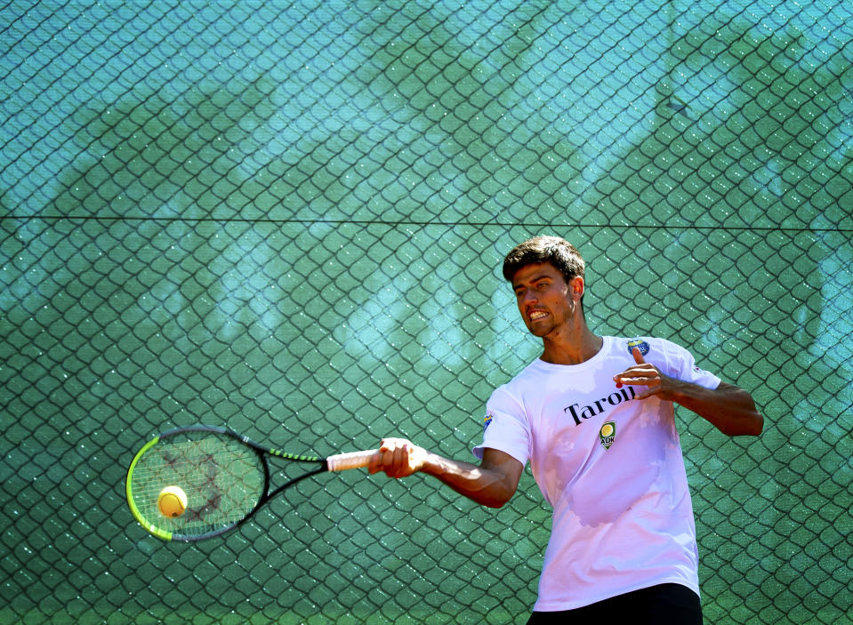 UBERABA, BRAZIL - AUGUST 03: Tennis Player Joao Menezes plays a forehand during a training session amidst the coronavirus (COVID-19) pandemic on August 3, 2020 in Uberaba, Brazil. Joao won the gold medal at the Pan American Games in Lima in 2019 and is qualified for the Tokyo Olympics. (Photo by Buda Mendes/Getty Images)