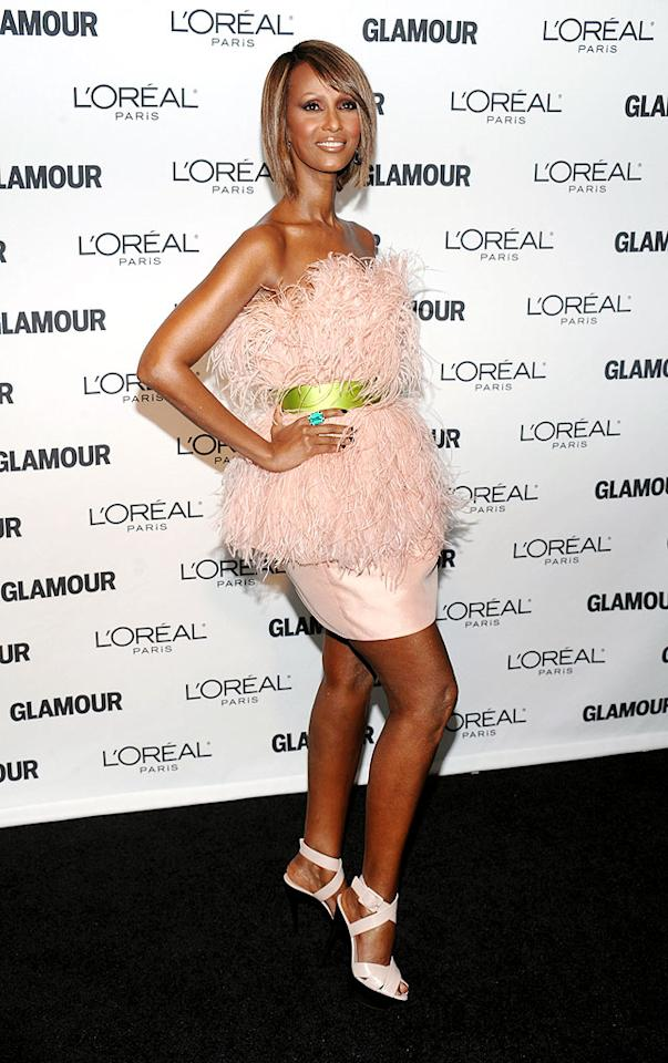 "Iman struck a pose in a fun feathered frock by Jason Wu. Is it us, or is the supermodel just getting better with age? Dimitrios Kambouris/<a href=""http://www.wireimage.com"" target=""new"">WireImage.com</a> - November 9, 2009"
